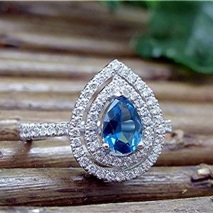 Diamond pear shape double halo ring