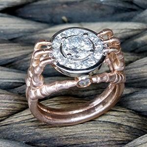 Diamond 14k gold skeleton hand ring