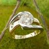 Off center bypass diamond ring