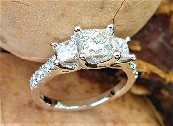 Lucida three stone princess cut engagement ring