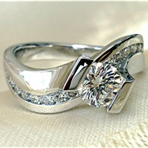 Tension set twisted engagement ring