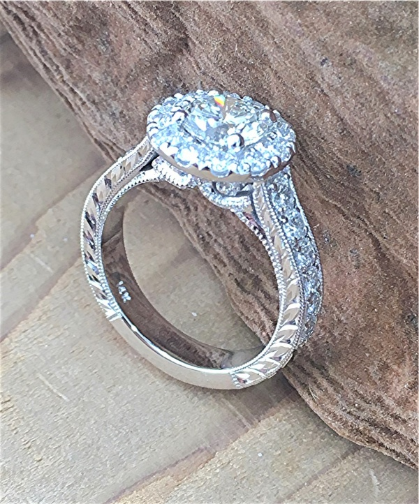 Diamond halo engagement ring with scroll work
