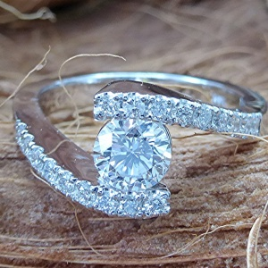 Bypass diamond engagement ring