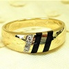 Diamond and onyx gold ring