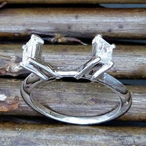 Trapezoid cut diamond wrap ring