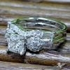 Engagement ring with custom made shadow matching band
