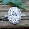 Four carat oval diamond engagement ring