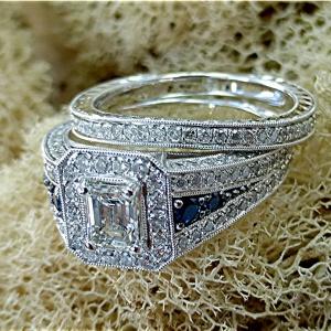 Emerald cut diamond engagement set.