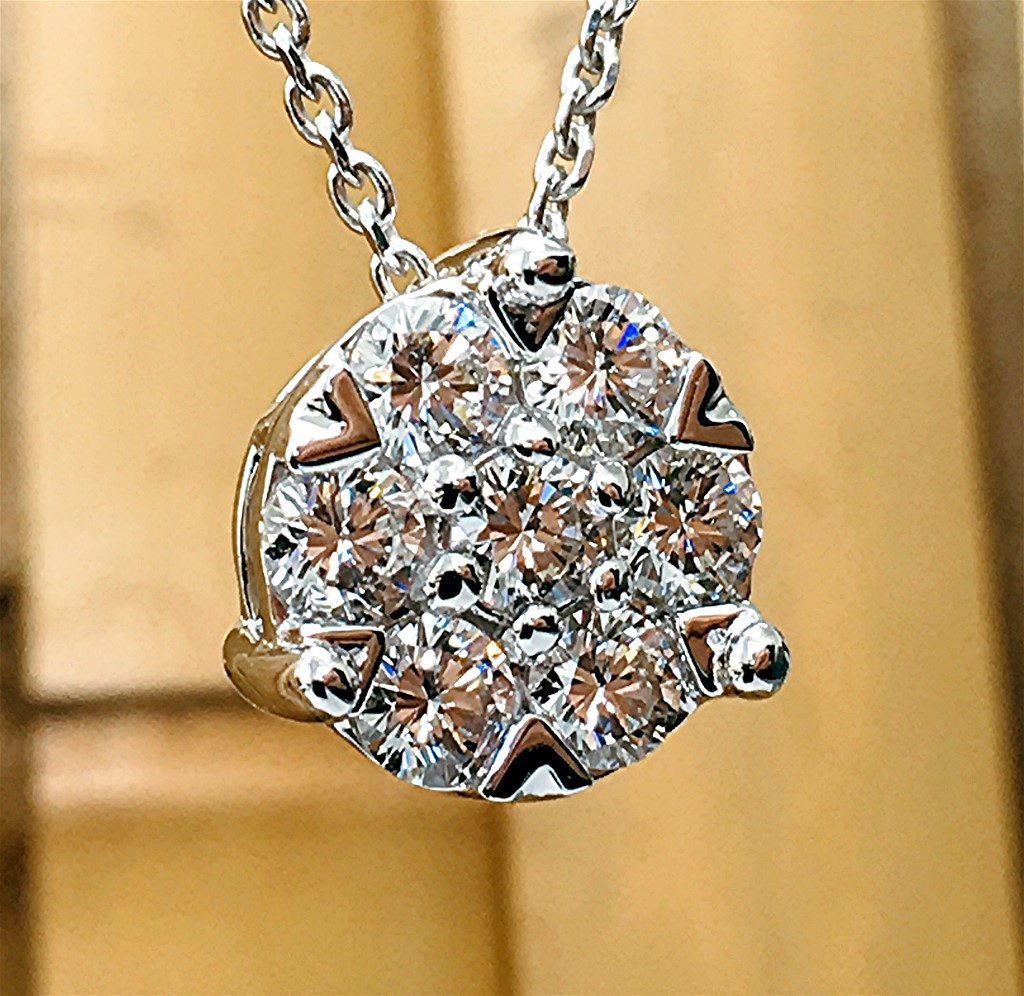 Seven diamond round cluster pendant