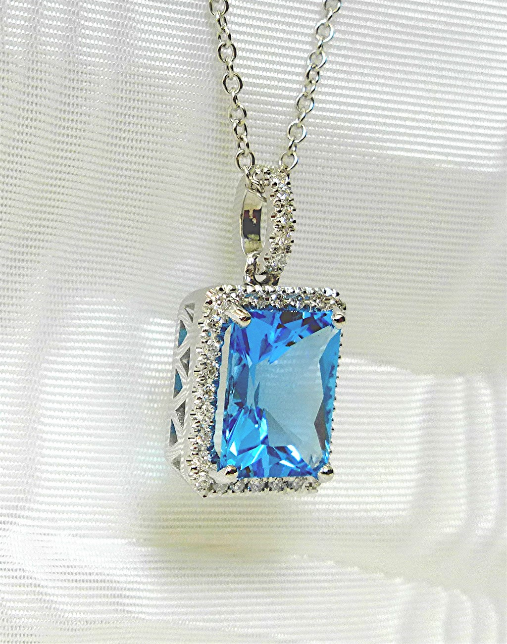 Matching Diamond and blue topaz pendant