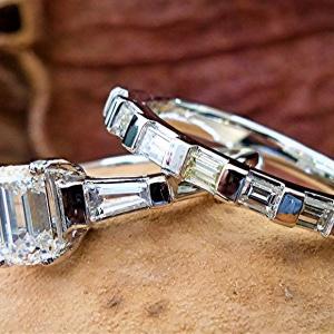 Three stone engagement ring and band set